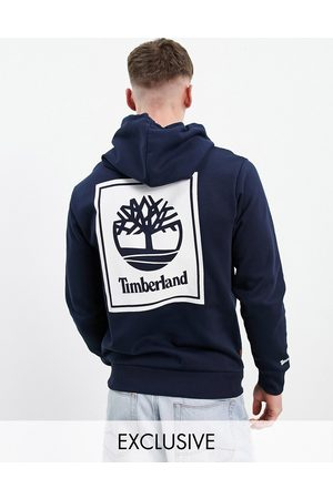 Timberland Stack back print hoodie in navy Exclusive at ASOS