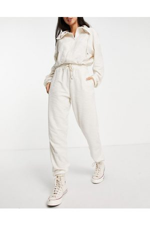 ASOS Tracksuit with funnel neck and jogger in slouchy texture in cream-Blue