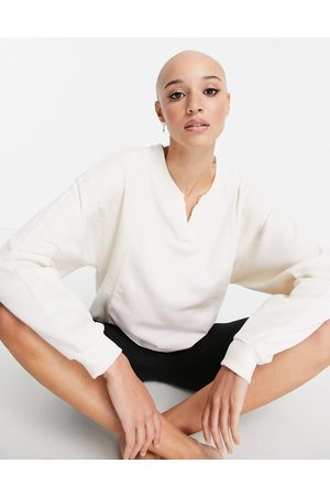 Nike Training Nike Yoga Luxe waffle cover up sweat in off white