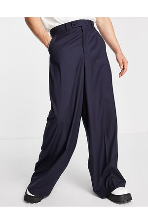 ASOS DESIGN Extreme wide leg suit trousers in navy