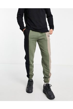 Good For Nothing Spliced joggers in black and khaki with mixed logo print-Multi