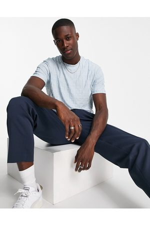 ASOS DESIGN T-shirt in blue all over embossed fabric