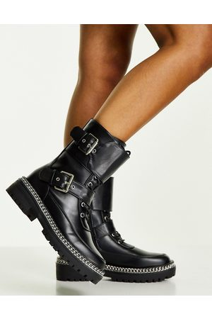 Truffle Collection Lace up buckle detail boots with chain sole in black
