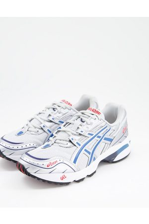 Asics Gel-1090 trainers in silver and blue
