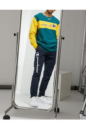Champion Large logo tracksuit bottoms in navy