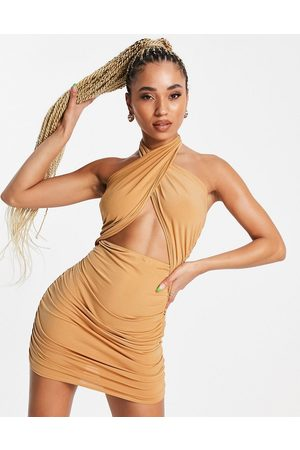 First Distraction The label tie front halter mini dress in beige-Neutral
