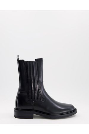 Bronx Flat high leg chelsea boots in black leather